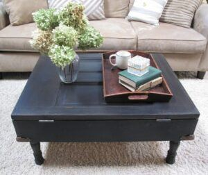 Coffee table made from an old door and painted black.
