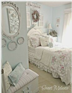 Shabby chic bedroom with layers of ruffles on bed.