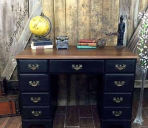 Wooden desk in navy blue.
