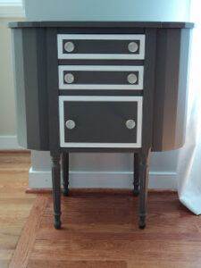 Martha Washington sewing cabinet painted in black.
